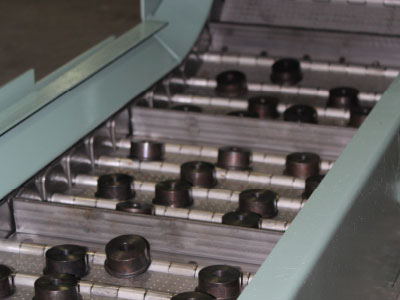 Conveyor for parts